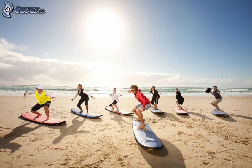 surfers on the beach, open sea, sun