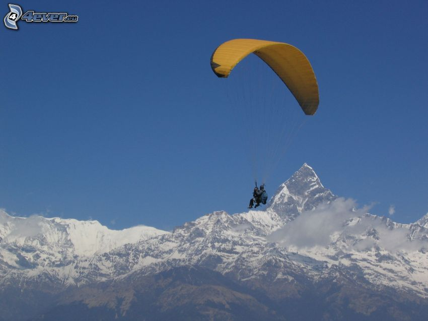 tandem paragliding, snowy mountains