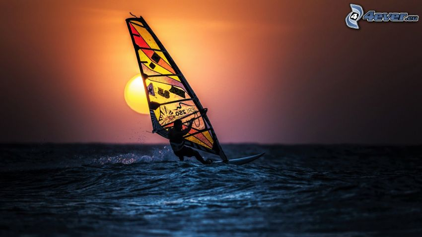 windsurfing, sunset over the sea