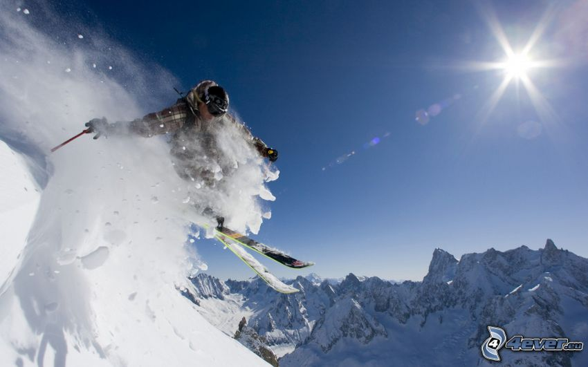 extreme skiing, jumping on the ski, snowy hills, sun