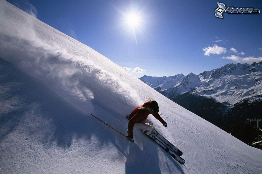 skiing, snowy mountains, sun