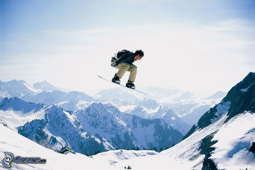 snowboard jump, snowy mountains