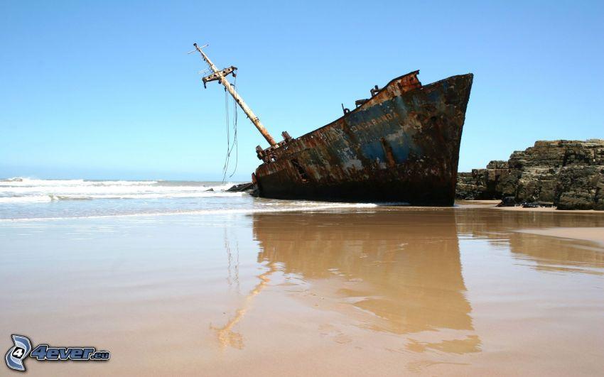abandoned rusty ship, sea, beach