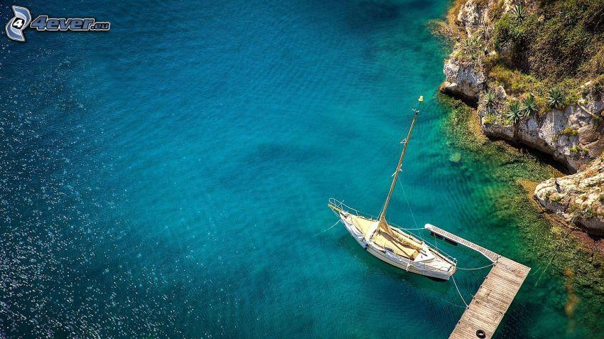 boat at sea, pier, rocky shores
