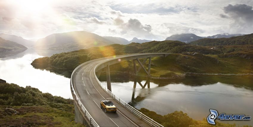 Land Rover DC100, road, bridge, landscape, sun, mountain