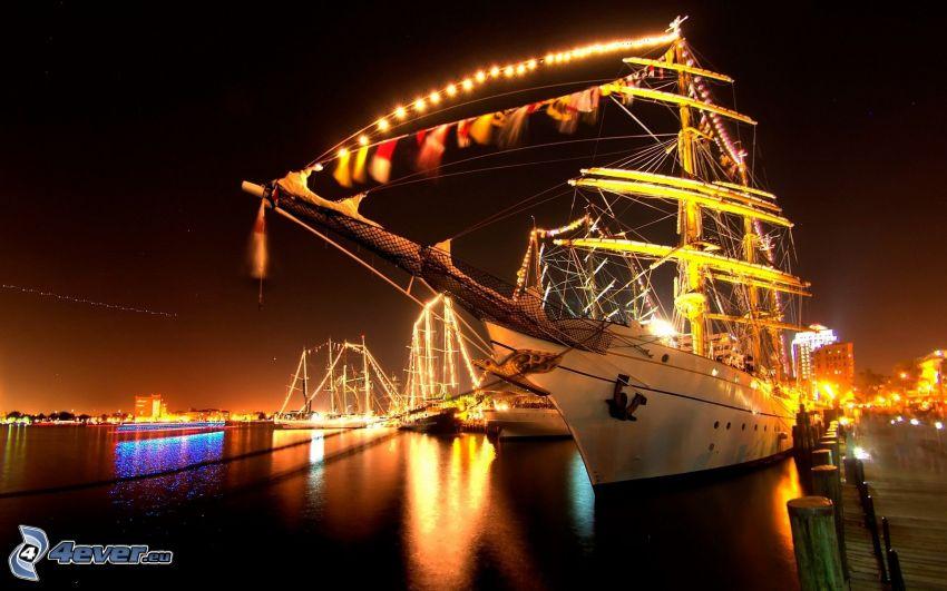 lighted boat, night