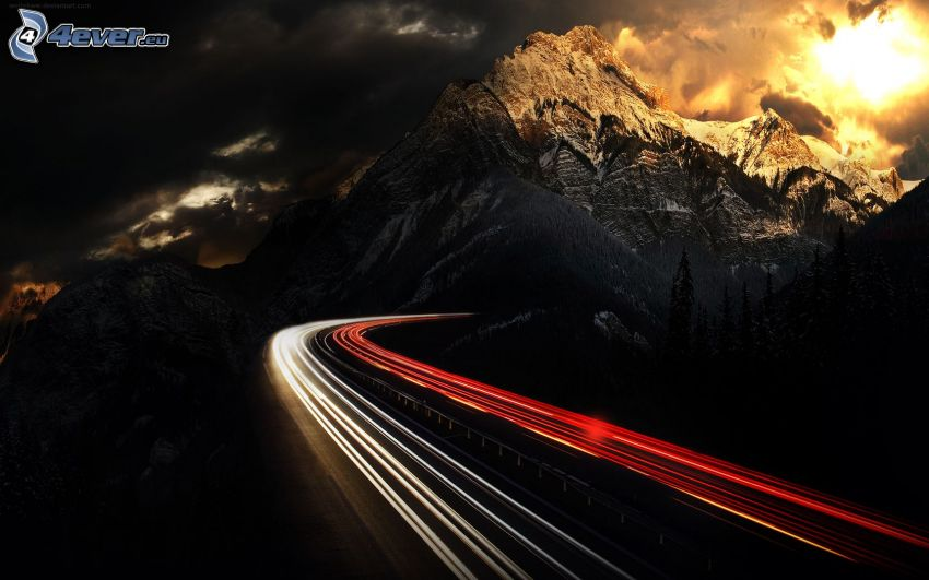 night highway, snowy mountains