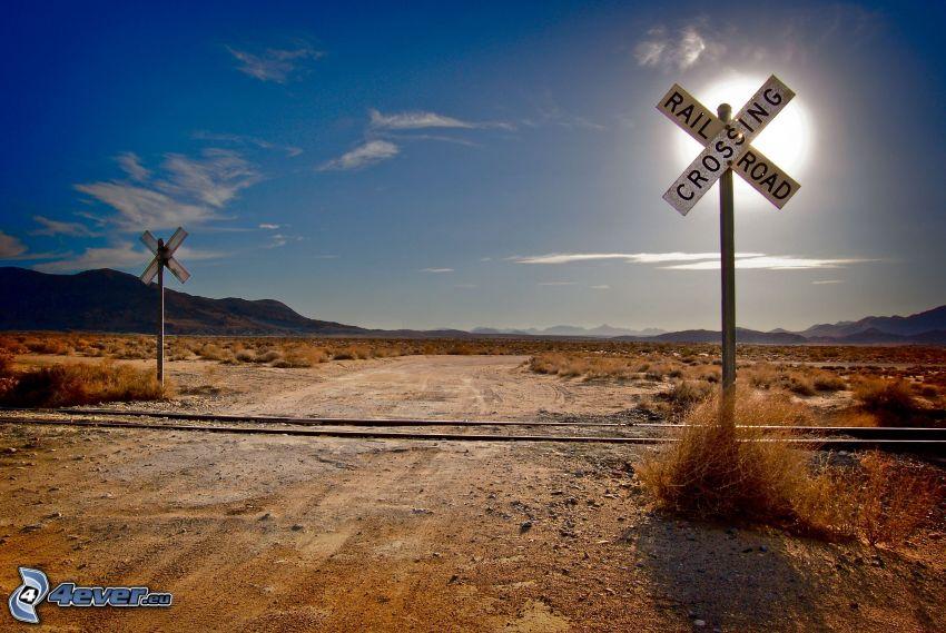 rail crossing, sun, USA