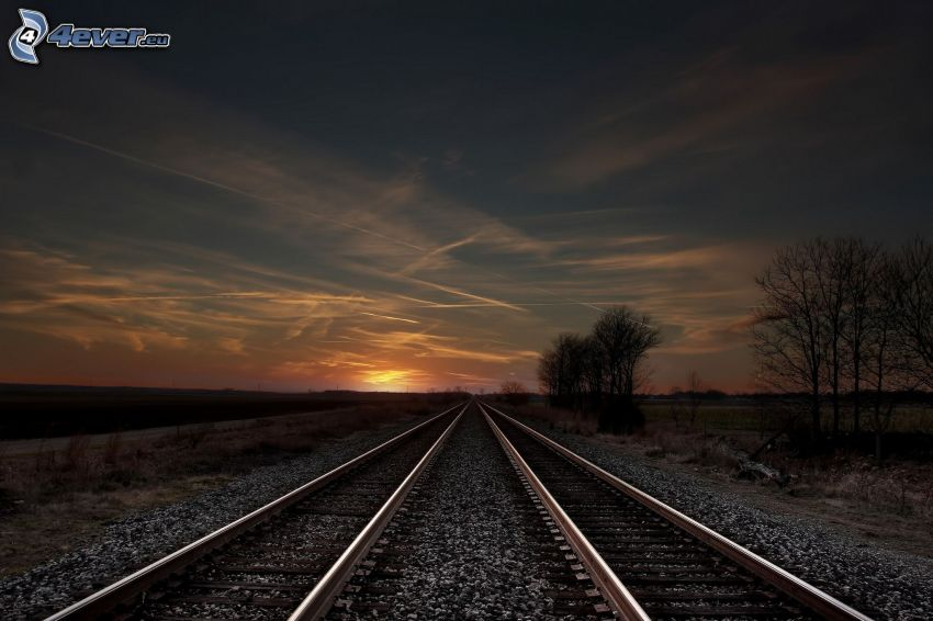 rails, evening sky, contrail