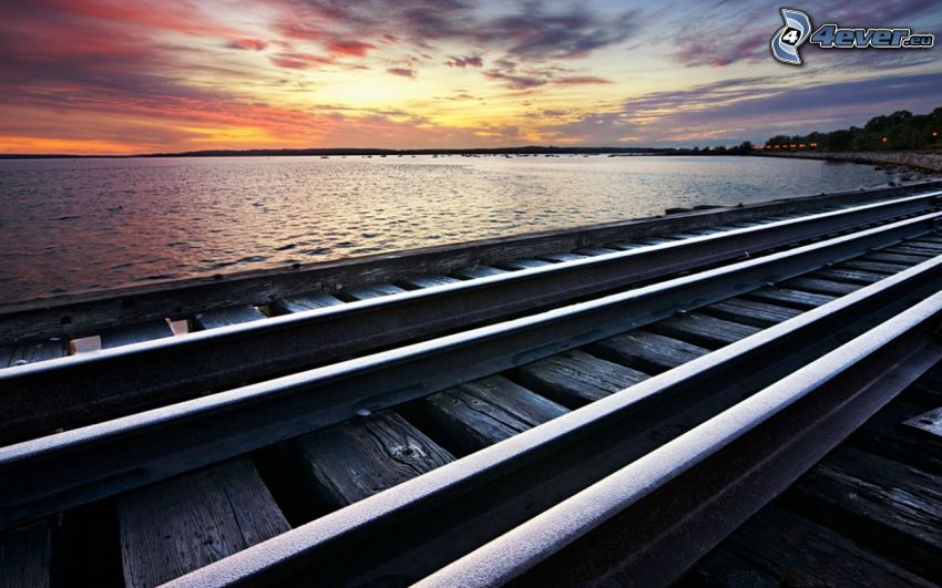 rails, lake, after sunset