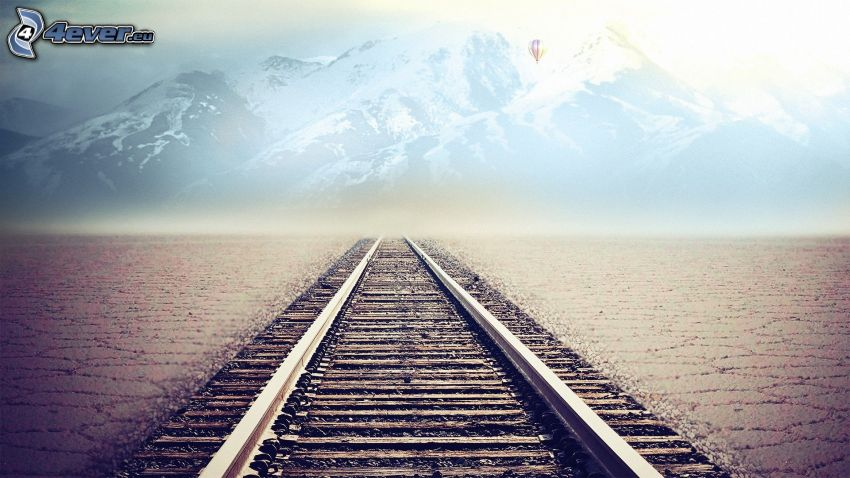 rails, snowy mountains